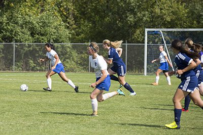 MPA students playing soccer