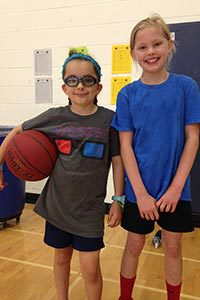 lower school students playing basketball