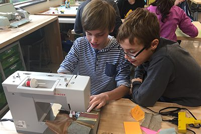 students sewing together crocodile costume