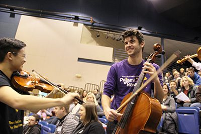 High school students playing orchestra instruments
