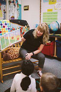 Kindergarten teacher reading a story