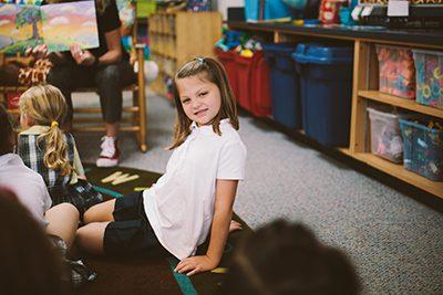 Kindergarten student listening to a story