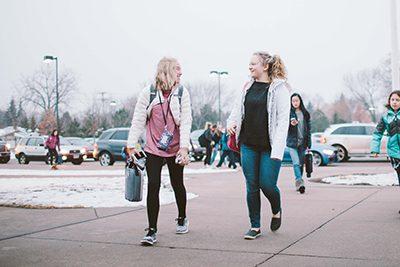 middle school girls walking into school