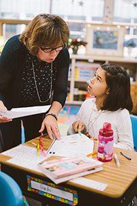 Teacher talking to student