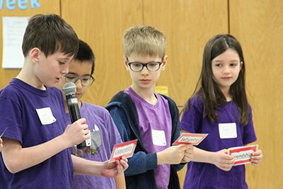 lower school students speaking at assembly