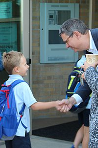 dr. Hudson welcoming students on first day of school