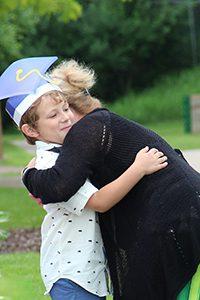 Ms. P hugging student