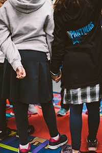 two students holding hands