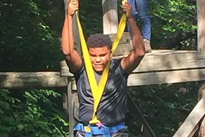student on ropes course