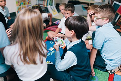 lower schoolers playing card game
