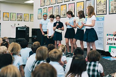 fourth graders give presentations to lower school