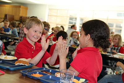 Two lower school kids in the cafeteria