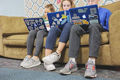 Middle Schoolers working on their laptops