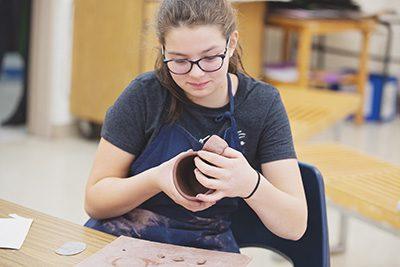 Middle Schooler in ceramics class