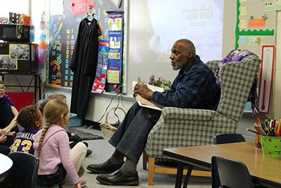 Justice Alan Page reading to kindergarteners
