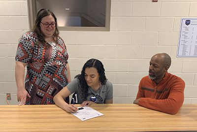 Maia Kelly signing letter of intent