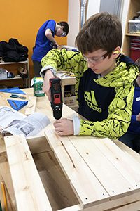 Middle Schooler in woodworking class