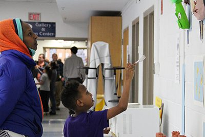 families view art at lower school art show