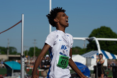 Yahya Madar celebrates after winning the state high jump