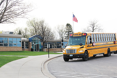 Bus pulling up to Mounds Park Academy