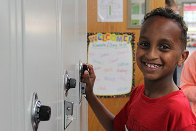 lower school student finds his locker at back to school night