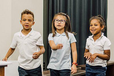 lower schoolers dancing in theatre