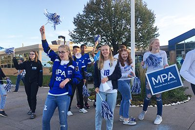 upper school students cheering during homecoming week spirit days