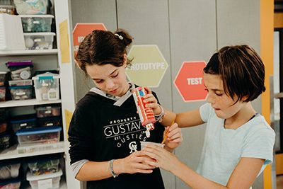 two middle schoolers working together in the makerspace