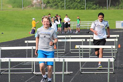middle school track and field day hurdlers