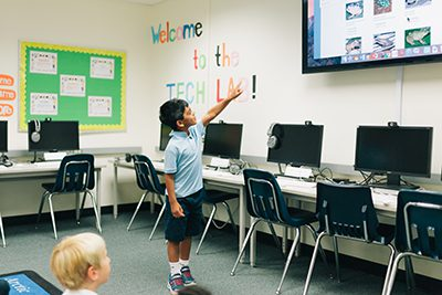 lower school student presenting in the tech lab