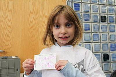 first grader making a thank you card for blood drive donors