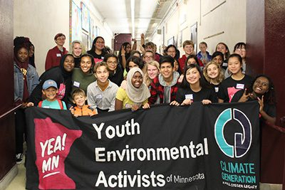 Jordan akers and Meera dear with group from the Youth Climate kickoff
