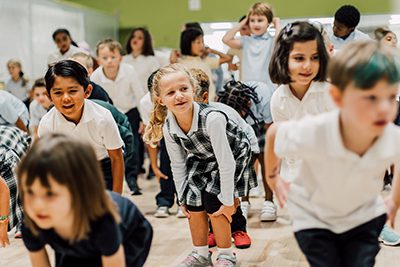 lower school warming up at the Monday morning meaning