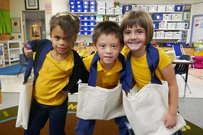 kindergartners with the canvas bags that they made