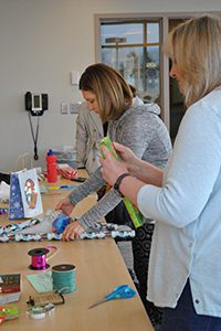 parents association wrapping gifts for faculty and staff
