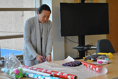 PA wrapping gifts for faculty and staff appreciation