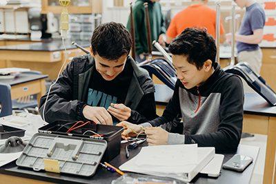 upper school students hands-on in science class