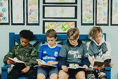 middle school boys reading together