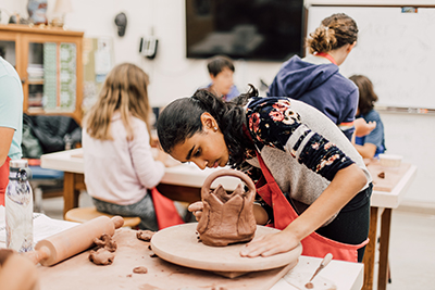 middle School student working in ceramics class