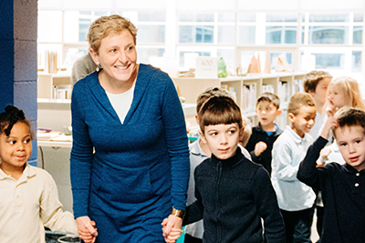 Nancy sage bringing lower schools students through the new library