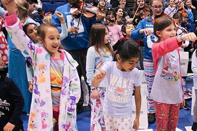 lower school students dancing at the pajamarama concert