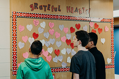students reading the grateful hearts