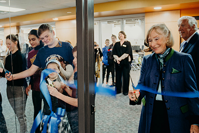 Ingrid cutting the ribbon to the library