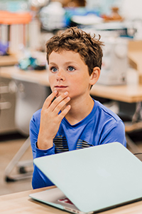 middle school student in class in the makerspace