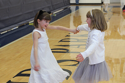 students at the 2019 white out dance dancing