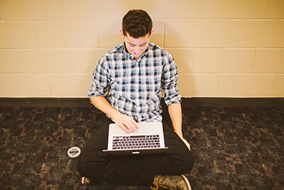 upper school student using his laptop
