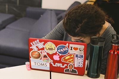 upper school student on her computer