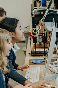 two third graders using the makerspace computer
