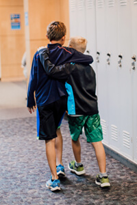 two middle school students walking in the hall together