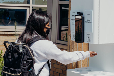upper school student using the health scan station
